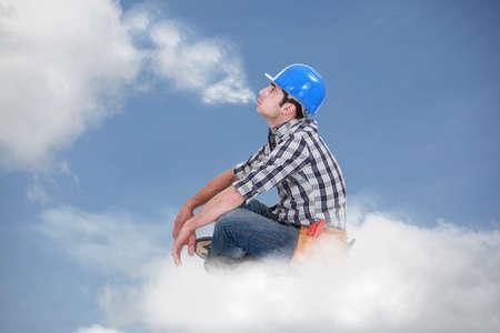 Workman sat on a cloud photo