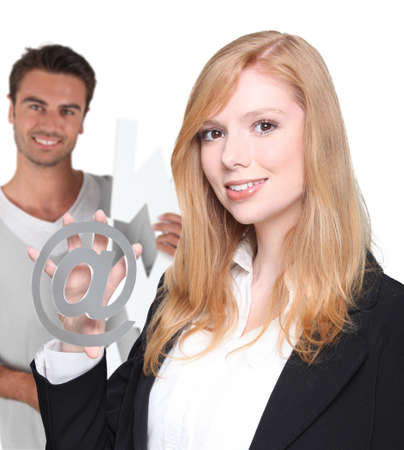 Office couple stood with at symbol photo
