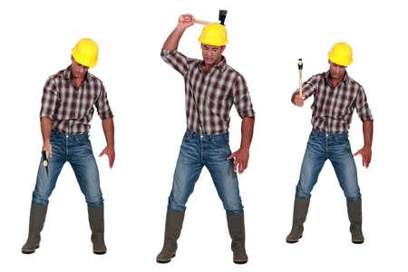 hatchet: Man using hatchet Stock Photo