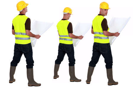 ingeniero civil: Arquitecto dobles planes de cheques Foto de archivo