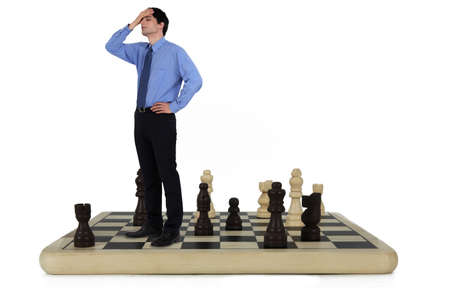 chess player: Man standing on a chess board