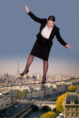 tightrope: Businesswoman balancing on tight rope Stock Photo