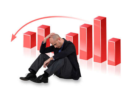 unhappy worker: Depressed businessman with a downward chart