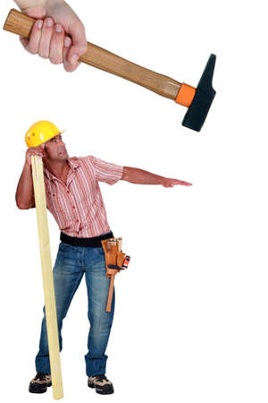 Construction worker being hit with a hammer photo