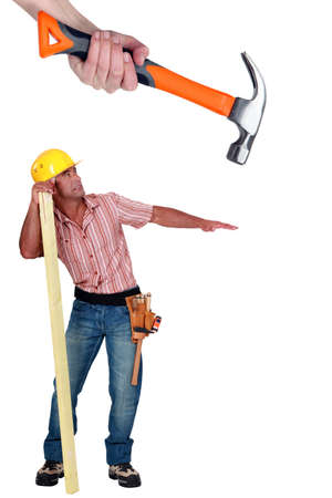 whack: Carpenter being attacked by giant hammer Stock Photo