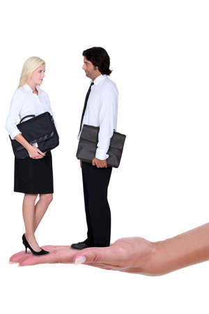 black lady talking: Business couple standing on a womans hand Stock Photo