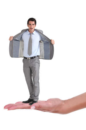 ego: Businessman with an open jacket on a womans hand