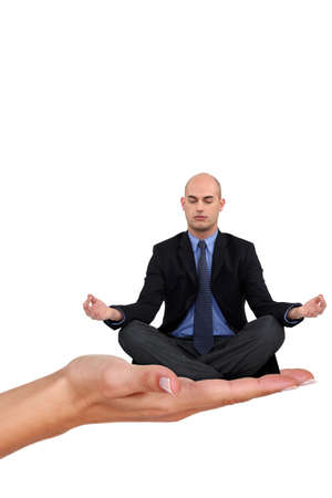 Bald businessman sat in yoga position photo