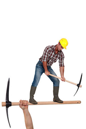 Man using pick-ax photo