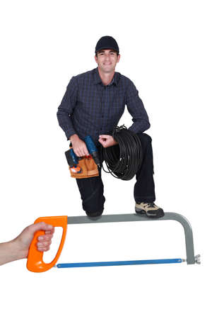 Electrician kneeling with drill photo