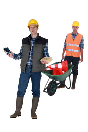 Two men with masonry equipment photo