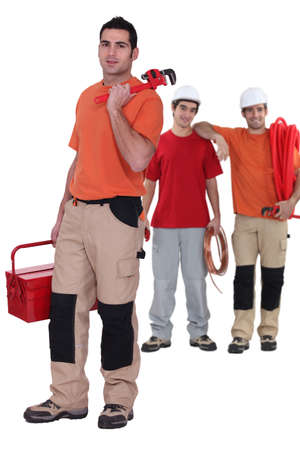 Three plumbers ready to work photo