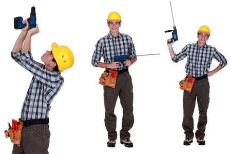 Handyman standing with power drill photo