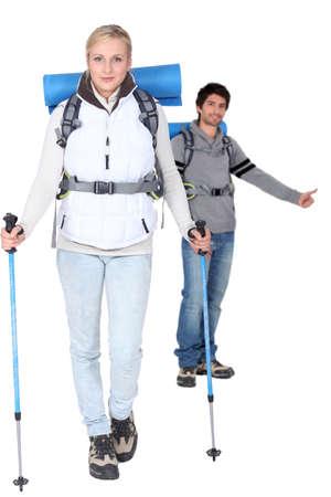 hitch hiker: Studio shot of a hiking couple Stock Photo