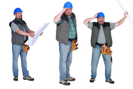 Chubby builder holding plans photo