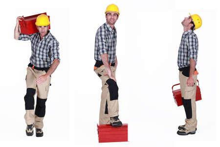 lumberman: Builder posing with a toolbox
