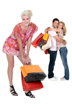 Three people with shopping bags photo