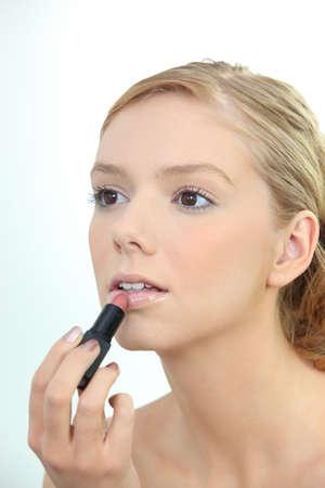 flawless: Woman applying lipstick