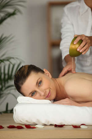 massaged: beautiful woman being massaged Stock Photo