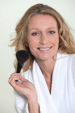 blusher: Woman with blusher brush Stock Photo