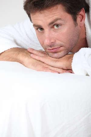laid back: man in bathrobe Stock Photo