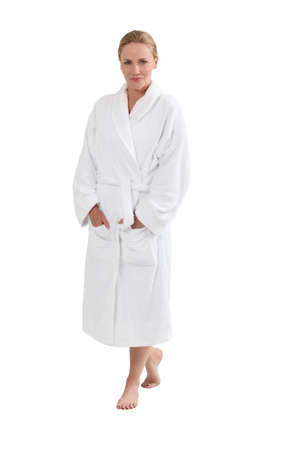 robe: Woman in bath robe with hands in pockets