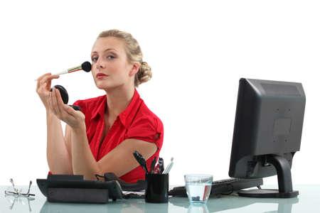 blusher: Office worker applying blusher