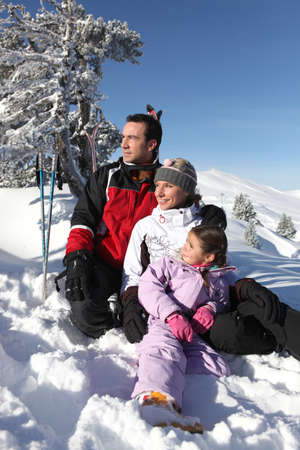 Portrait of a family on a skiing holiday together photo