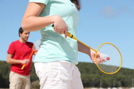 badminton racket: Couple playing badminton