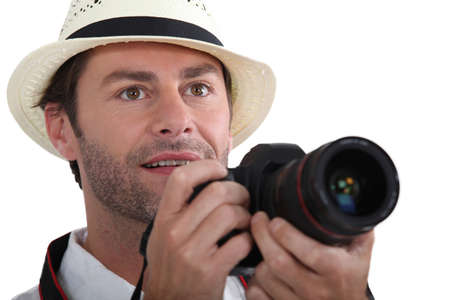 sightsee: Tourist taking a photo with a DLSR camera