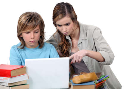 Two kids studying together photo