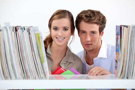 Young couple in library photo