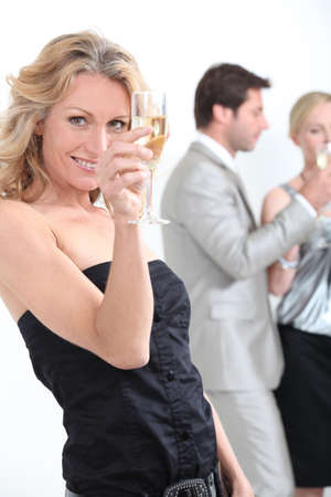 Woman drinking champagne photo