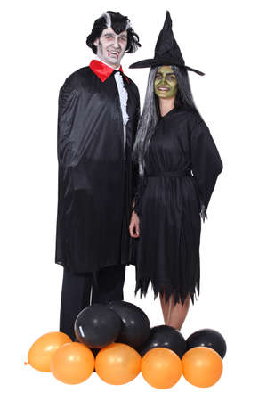 Couple dressed in Halloween costumes photo