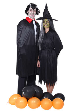 disguised: Couple disguised in vampire and witch