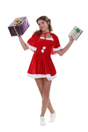 aloft: Smiling Miss Santa holding aloft some Christmas gifts