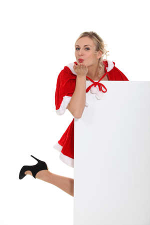 hankering: lady wearing a Christmas costume and blowing a kiss