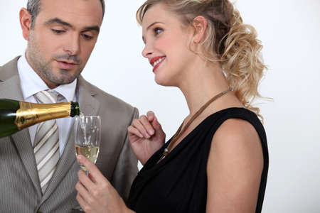 verve: Woman serving champagne Stock Photo
