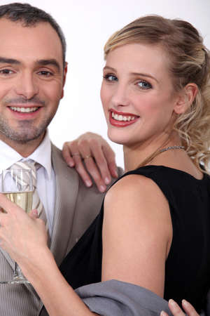 'evening wear': Couple in evening wear drinking champagne Stock Photo