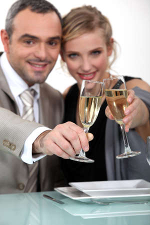 imply: Couple toasting with champagne