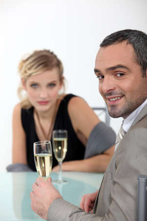 handome: Successful couple toasting with champagne