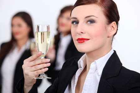 champagne toast: Businesswomen with champagne Stock Photo