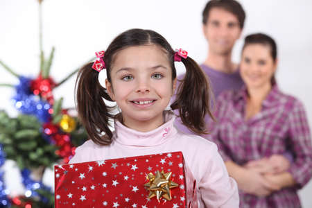 Young family at Christmas Stock Photo - 18463568