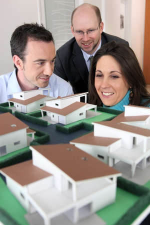 Architect showing model housing to customers photo