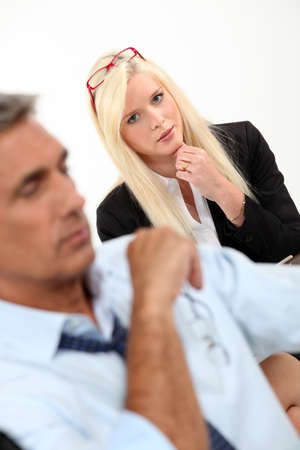 observant: Woman at work meeting with a man