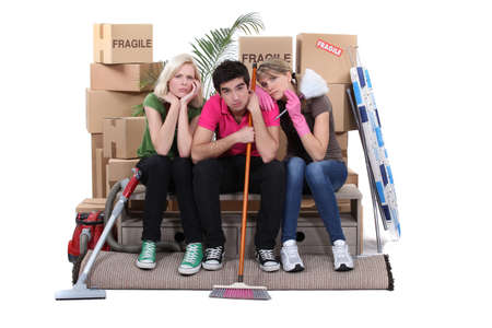 bummed: Unhappy housemates cleaning their flat before moving out Stock Photo