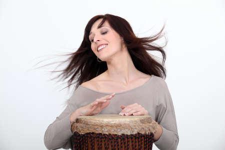 bongo drum: Woman playing bongo