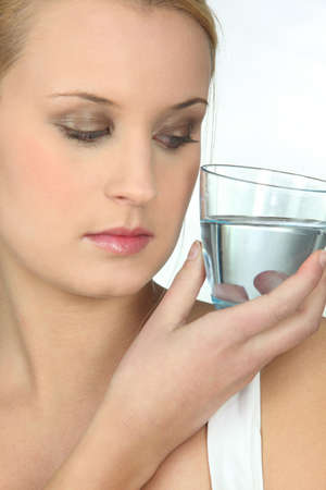 pureness: Woman looking at a glass of water Stock Photo
