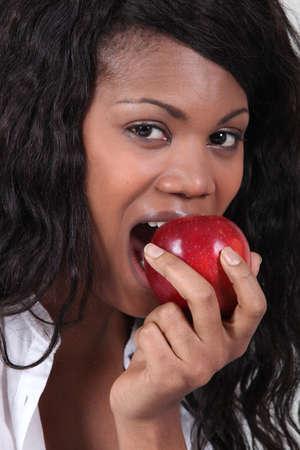 Woman biting apple photo