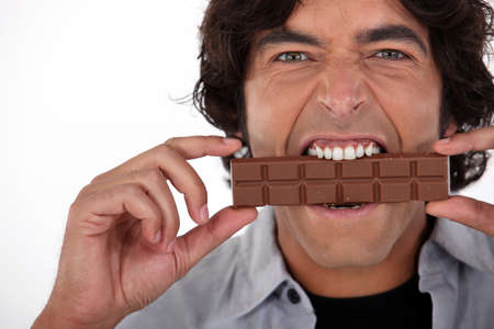 fanatic studio: Man playfully eating chocolate